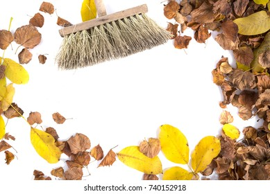 Autumnal leaves and broom isolated on white background
