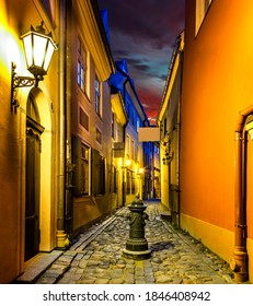 Autumnal night in European town, nocturnal view on medieval street