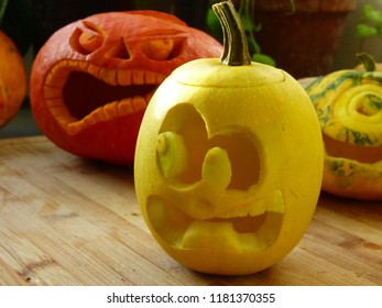 Autumnal vegetables. Yellow squash scared by a little spooky pumpking behind. Halloween scenario, funny and uncommon scene, vegan war. Don't be afraid of vegetables, just eat them !