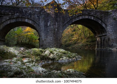 An autumnal view of Holne Bridge on the river Teign in Dartmoor, England