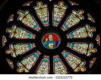 AUVERS-SUR-OISE, ILE-DE-FRANCE, FRANCE. July 21, 2013. Stained glass window in Notre Dame de l'Assomption church