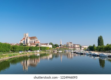 AUXERRE, FRANCE - JUNE 2018: Cityscape of Auxerre with Yonne river and Abbey of Saint-Germain, Burgundy, France