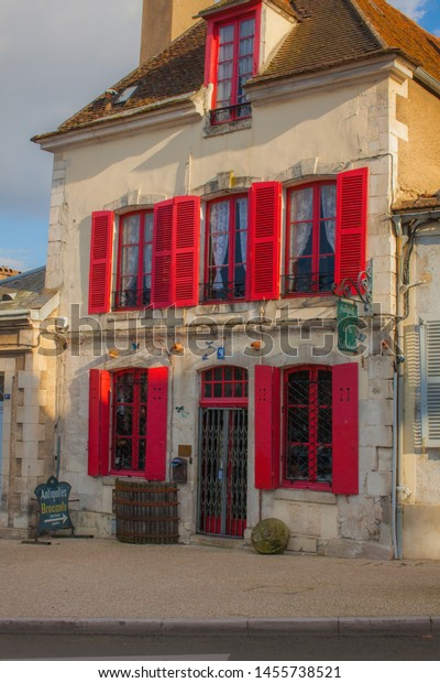 Auxerre, France - March 05 2014 : The  authentic building style of the bourgondy is ever present. Here the shutters are in red.