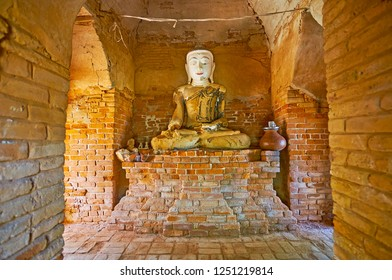 AVA, MYANMAR - FEBRUARY 21, 2018: Interior of shrine in Daw Gyan Pagoda complex with image of Lord Buddha Touching Earth, on February 21 in Ava.