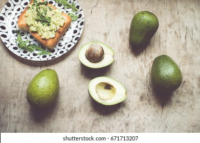 Avacado in a wooden background/toned photo