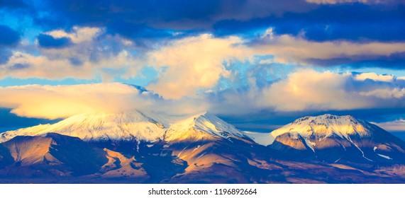 Avachinsky and Kozelsky volcanoes on the Kamchatka Peninsula at sunset in autumn