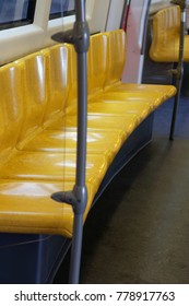 Available yellow seats In the train / no passenger on the seats.