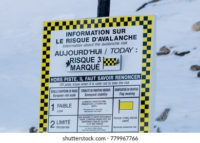 Avalanche warning sign in the French Alps.  The sign tells of a high risk of avalanche