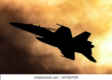Avalon, Australia - February 26, 2013: Royal Australian Air Force (RAAF) Boeing F/A-18F Super Hornet multirole fighter aircraft silhouetted against a sunset.