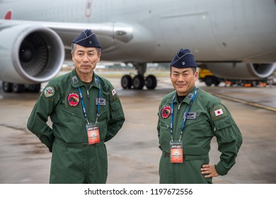 Avalon, Australia - February 26, 2013: Japan Air Self Defense Force (JASDF) air crew from 404 Squadron, 1st Tactical Airlift wing in front of a Boeing 767 transport aircraft.
