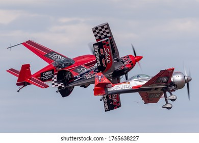 Avalon, Australia - February 28, 2015: Aerobatic pilots Melissa Pembertonin an Extra 300, Skip Stewart in his Pitss S-2 and Jurgis Kairys flying his Juka aerobatics aircraft in close formation.