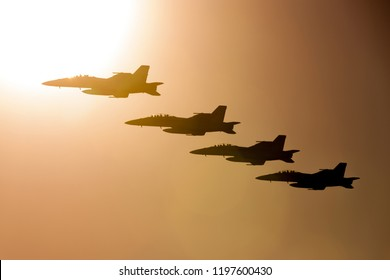 Avalon, Australia - March 1, 2013: Four Royal Australian Air Force (RAAF) Boeing F/A-18F Super Hornet multirole fighter aircraft flying in formation at sunset.