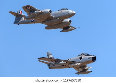 Avalon, Australia - March 2, 2013: Gloster Meteor F.8 aircraft VH-MBX leading a CAC CA-27 Sabre (North American F-86) in formation.