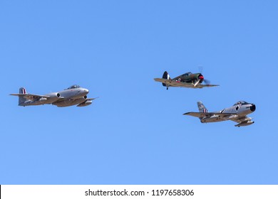 Avalon, Australia - March 2, 2013: Former Royal Australian Air Force (RAAF) Commonwealth Aircraft Corporation CA-13 Boomerang fighter aircraft VH-MHR with a Gloster Meteor and CAC Sabre in formation.