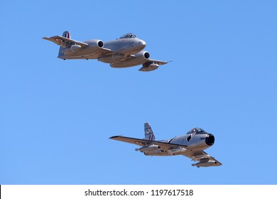 Avalon, Australia - March 3, 2013: Gloster Meteor F.8 aircraft VH-MBX leading a CAC CA-27 Sabre (North American F-86) in formation.