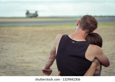 Avalon, Melbourne, Australia - Mar 3, 2019: Couple hugging at the airshow
