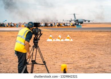 Avalon, Melbourne, Australia - Mar 3, 2019: Cameraman at the airshow