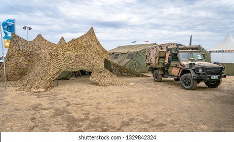 Avalon, Melbourne, Australia - Mar 3, 2019: Military camouflaged tent and a 4WD