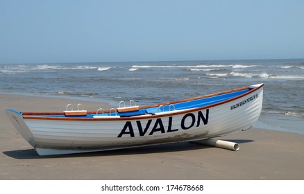AVALON, NEW JERSEY - June 26, 2013.  A beach patrol boat rests on the shore in Avalon, New Jersey welcoming visitors back after Hurricane Sandy devastated parts of the area several months earlier.