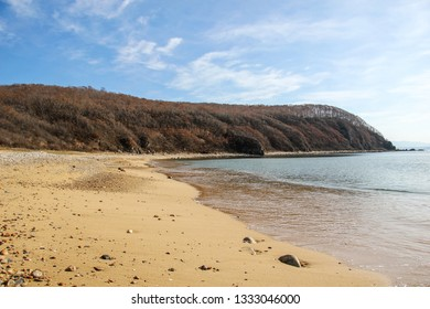Avangard Bay, Livadia, Nakhodka city, Primorsky Region, Russia.  Landscape view of the fall foliage of the cape of Japan Sea