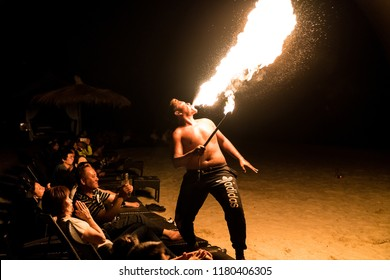 AVANI GOLDCOAST, SEPANG  - MALYASIA - 09 AUGUST 2018  - As close as it gets to the audience as a stuntman sprays fire into the air