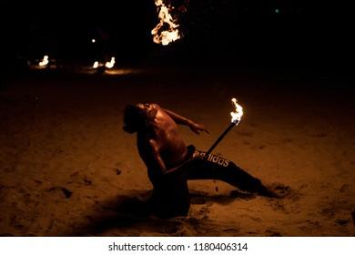 AVANI GOLDCOAST, SEPANG  - MALYASIA - 09 AUGUST 2018  -  A stuntman sprays fire into the air