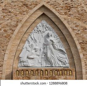AVE MARIA, FLORIDA, USA - DECEMBER 12, 2018: Facade of the Ave Maria Catholic Church The front of the church displays sculptor Marton Varo's 30-foot-tall sculpture of the Annunciation.