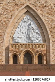 AVE MARIA, FLORIDA, USA - DECEMBER 12, 2018: Entrance of the Ave Maria Catholic Church. The front of the church displays sculptor Marton Varo's 30-foot-tall sculpture of the Annunciation