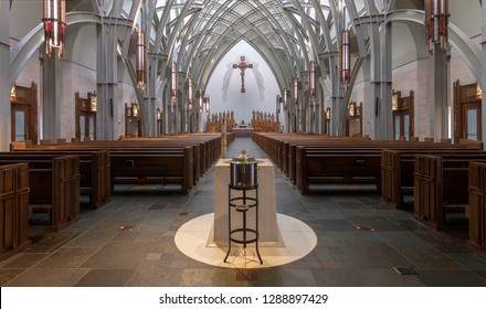 AVE MARIA, FLORIDA, USA - DECEMBER 12, 2018: The baptismal font inside Ave Maria Catholic Church. The baptismal weighs 3,500 pounds and was carved from a single block of white marble.