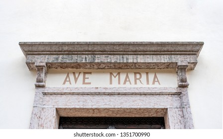 ave maria written on architrave of old church in Trentino Italy