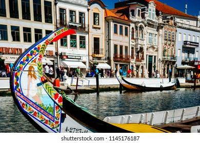 Aveiro, Aveiro/Portugal - 09 18 2015:Tourists walking along the canal in Aveiro Portugal. Empty gondolas.