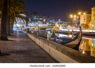 Aveiro city with traditional Moliceiro boats in the canal by night