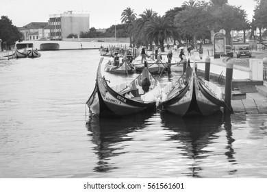 AVEIRO, COIMBRA / PORTUGAL - SEPTEMBER 14, 2016: View of the romantic city of Aveiro with gondolas in the canals in the late afternoon