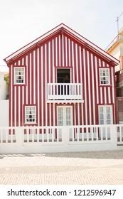 Aveiro, Portugal - 08, 17, 2018: red house in Costa Nova, Aveiro, Portugal