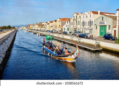 Aveiro / Portugal - 08.12.2017: View for water canal with boat in Aveiro, Portugal