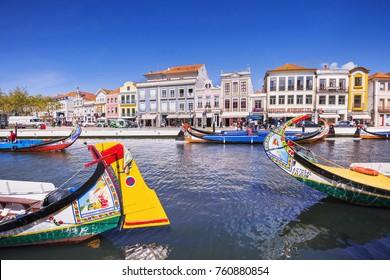 AVEIRO, PORTUGAL - APRIL 1, 2017: Traditional Moliceiro boats on main city canal in Aveiro, Portugal, popular european tourist destination and landmark