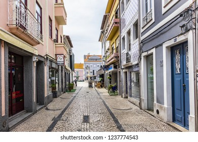AVEIRO, PORTUGAL - APRIL 20, 2017: Street view in the heart of Historic Center of Aveiro: Narrow city streets with typical Portuguese houses.