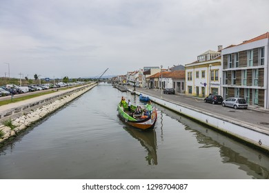 AVEIRO, PORTUGAL - APRIL 20, 2017: View of traditional Moliceiro boats (gondolas) with tourists on the canal in Aveiro. Aveiro known as Venice of Portugal.