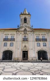 AVEIRO, PORTUGAL - APRIL 20, 2017: Fragment of Republic Square (Praca da Republica) in Aveiro. The tree-lined Praca da Republica is at the heart of city life in Aveiro.