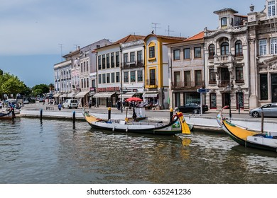 AVEIRO, PORTUGAL - APRIL 20, 2017: View of the main City canal and Vouga River with traditional Moliceiro boats (gondolas) on the canal.