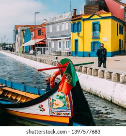 Aveiro, Portugal - April 29, 2019: Traditional boats on the canal in Aveiro, Portugal. Colorful Moliceiro boat rides in Aveiro are popular with tourists to enjoy views of the charming canals.