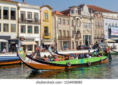 Aveiro, Portugal. Circa October 2017. Colorful  boats, called moliceiros, transport tourists through Aveiro net of canals.