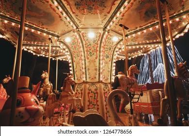 Aveiro, Portugal - December 21, 2018: Close-up of illuminated and deserted carousel ride in Cais da Fonte Nova.