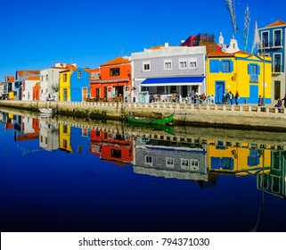 AVEIRO, PORTUGAL - DECEMBER 23, 2017: View of canals, boats, colorful houses, local businesses, locals and visitors, in Aveiro, Portugal