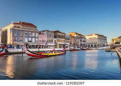 Aveiro, Portugal. July 28, 2018. Central canal in Aveiro, with traditional boat, Moliceiro, to transport tourists visiting the city canals. Center of the city of Aveiro.