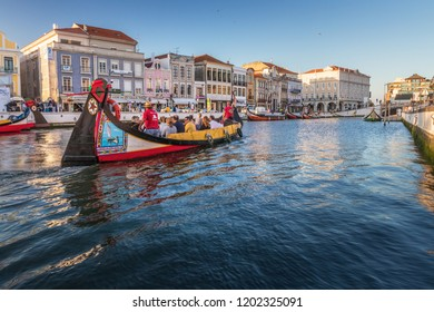 Aveiro, Portugal. July 28, 2018. Central canal in Aveiro, with traditional boat, Moliceiro, to transport tourists visiting the city canals. Center of the city of Aveiro, in Portugal.