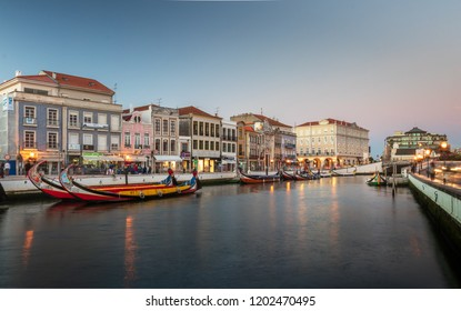 Aveiro, Portugal. July 28, 2018. Central canal in Aveiro, with several moliceiros anchored and houses Art Noveau in the background at dusk. Center of the city of Aveiro, in Portugal.