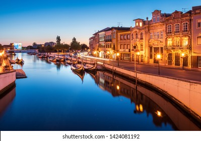 Aveiro, Portugal - June 08, 2019: Central water canal of the city of Aveiro, with moliceiros, traditional boats, anchored on the banks. On the banks we also have houses of Art Nouveau architecture.