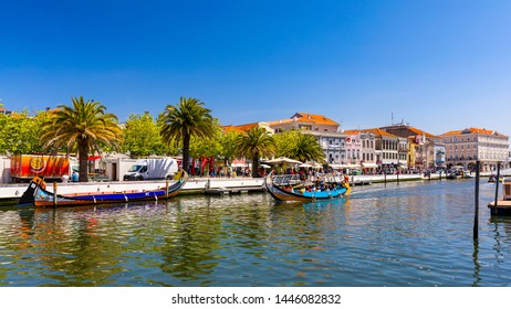 Aveiro, Portugal - June 16, 2018: Traditional boats on the canal in Aveiro, Portugal. Colorful Moliceiro boat rides in Aveiro are popular with tourists to enjoy views of the charming canals.
