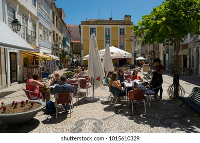 AVEIRO, PORTUGAL - June 28, 2016: Locals and tourists in the 14th July Square in the popular tourist city of Aveiro, Portugal.
